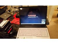 "toshiba 17"" laptop dual core 1.8 2gb ram radeon graphics wifi dvd-writer windows 7"