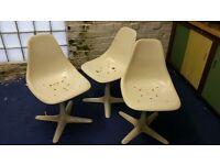 4 white retro chairs