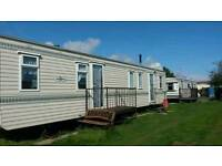 Lovely home from home caravans to let across from fantasy island.