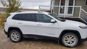 2015 Jeep Cherokee with extra winter rims and tires