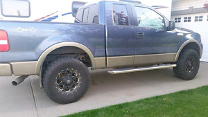 Ford F150 Lariat-fully loaded-lifted