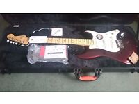 Fender American Standard Stratocaster finished in Bordeaux Metallic.
