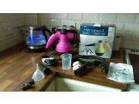 Pink handheld steam cleaner