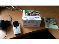 Nokia 2310 phone with charger box and user manual
