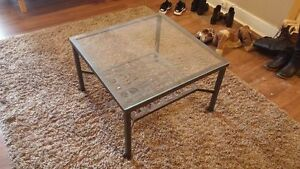 Metal-framed coffee table with glass surface