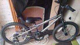 Boy's black and silver bike