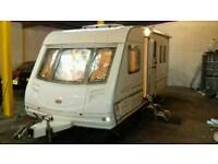 Fixed bed caravan with motor, Fiamma canopy and accessories