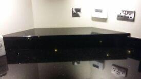 Black granite worktop including sink