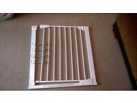 Mothercare auto close stair gate.
