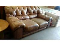 Light brown leather chesterfield style sofa
