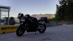 Stolen: 2012 Honda CBR 600rr, Black. If seen, call police.