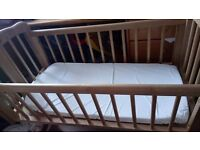 Mothercare swinging crib with mattress and sheets