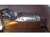 Single bed with pull out guest bed underneath