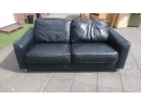 Black Designer Leather 2 Seater Sofa in very good condition no rips or tears a nice free delivery