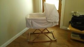 silver cross carrycot + rocking Moses basket stand, with white hood and liner.