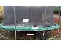 10ft x 15ft JumpKing Trampoline for sale including cover and enclosure - only two years old