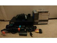 PlayStation 2/Ps2 Fat bundle, 10 ps2 games, 1 ps1 game and accessories