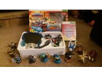 Xbox 360 skylanders superchargers game, vehicles, and figures.