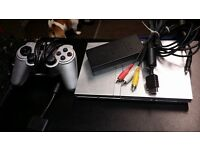 Silver PS2 slim with matching pad. Complete and ready to use.