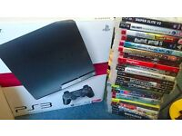 PS3 Console with 2 controllers, singstar microphones and 25 games