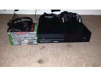 xbox one(1tb) 2 controllers 1 headset and 7 games plus 5 downloaded to box.