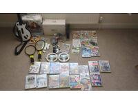 Mega Nintendo Wii Bundle With Guitar Hero and tons of games