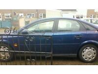 Blue hatchback.