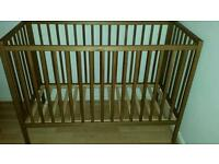 Light brown baby cot