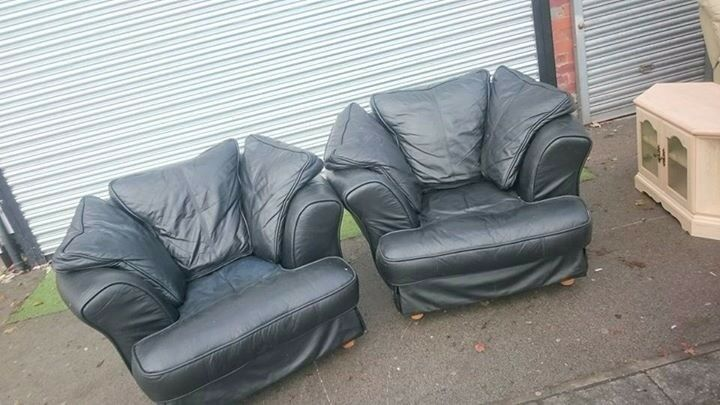 Set of Two designer black leather armchairs very comfy can deliver local