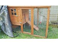 Two outdoor rabbit hutches.