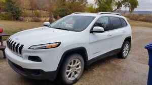 2015 jeep Cherokee with extra winter tires and rims