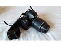 Nikon D3000 DSLR camera + 18-55mm lense