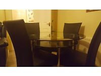 2 tier glass table with black rim edge + 4 leather chairs