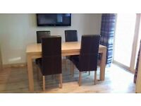 Sterling Oak coloured dining table & 4 brown leather chairs CAN DELIVER