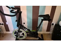 JLL Indoor Cycling Exercise Bike, Ergonomic Handlebars and Fully Adjustable Seat, Built In Wheels.