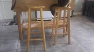 2 Bar stools , 1 Slightly higher then other