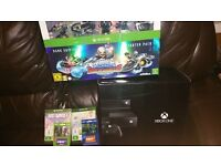 Very rare new and sealed day one xbox one console with kinect, games and now tv vouchers.
