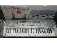 BRAND NEW ** SILVER 49 KEY FUNCTION ELECTRIC KEYBOARD