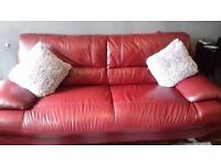 I am selling a two seater sofa and a three seater sofa, in a lovely deep red colour.