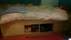 single bed base, beech effect with 4 storage drawers.