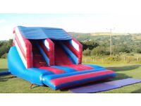 Inflatable bouncy slide