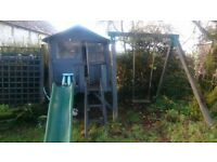 Wooden playhouse, slide and swing