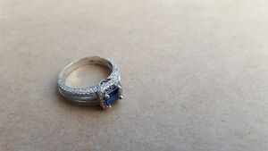 14 KW WEIGHT PRINCESS CUT SAPPHIRE RING WITH 204 DIAMONDS