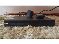 Brand new lg dvd blue ray player with remote,windows media usb port needs scart audio lead