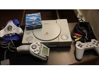 PS1 Console. 1 Original controller. Gamester (Gyro-controller). GameShark-1. all included.