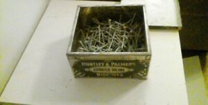nails in antique container