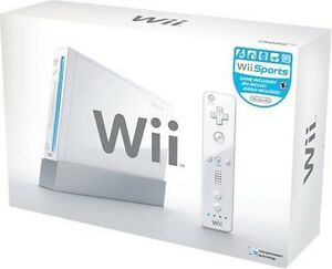 WII console w/ Super Mario Bros, DK Country Returns