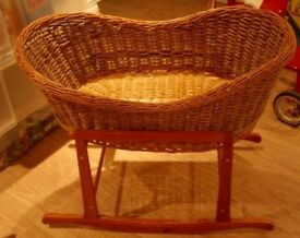 Large wicker bassinet with rocker stand for sale, excellent condition