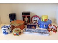 assorted collectable storage tins