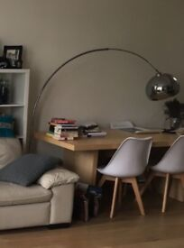 Giant curved floor lamp with chrome shade